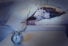 Woman in bed with insomnia that can't sleep white background Stock Photography