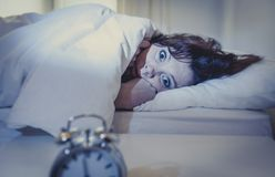 Woman in bed with insomnia that can't sleep white background Royalty Free Stock Image