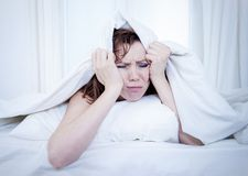 Woman in bed with insomnia that can't sleep white background royalty free stock images