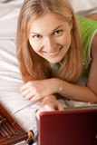 Woman in bed with laptop Stock Photography