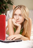 Woman in bed with laptop Stock Images