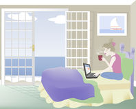 Woman on Bed with Laptop Stock Photo