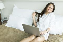 Woman in the bed with laptop Royalty Free Stock Image