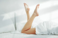 Woman on the bed Royalty Free Stock Image