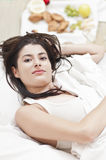 Woman on bed looking at camera Royalty Free Stock Images