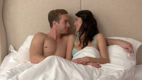 Woman in bed with man. stock video footage