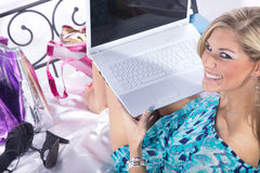 Woman in bed with the online sale Royalty Free Stock Photos