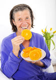 Woman in bed with oranges Stock Photography