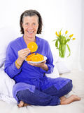 Woman in bed with oranges Royalty Free Stock Photography