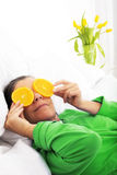 Woman in bed with oranges Stock Images