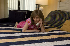 Bedroom Chit-Chat on a Phone Royalty Free Stock Photo