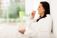 Woman bed popcorn Stock Photos