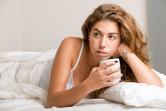 Woman in Bed Relaxing Stock Images