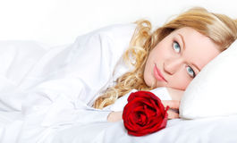 Woman In Bed With Rose Royalty Free Stock Images