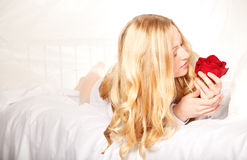 Woman In Bed With Rose Stock Images