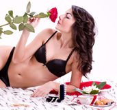 woman in bed with rose Stock Photography