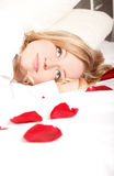 Woman In Bed With Rose Petals Royalty Free Stock Image