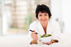 Woman bed salad Royalty Free Stock Photos