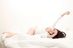 Woman in bed sleeping Stock Image