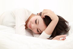 Woman in bed sleeping Stock Photography