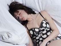 Woman in bed sleeping Stock Photos