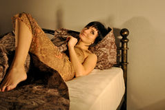 Woman bed sleepwear rest Stock Photography