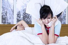 Woman in bed with a snoring man Stock Image