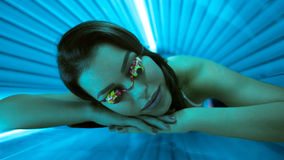 Woman in bed solarium Stock Image