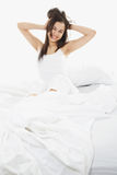 Woman in Bed. Stock image of woman in bed, white bedding Stock Photography