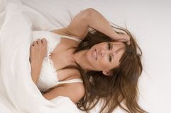 Woman in bed suffers from a headache Royalty Free Stock Photo