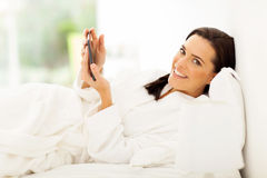 Woman bed tablet Stock Image