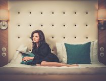 Woman on a bed with tablet pc Royalty Free Stock Photo