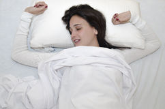 Woman in bed top view Stock Images