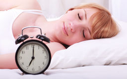 Woman in bed trying to wake up Stock Images