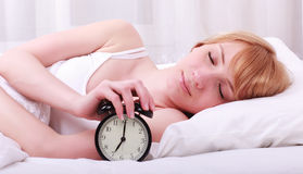 Woman in bed trying to wake up Royalty Free Stock Images