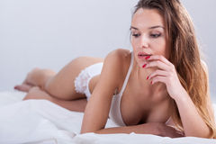 Woman in bed waiting for partner Stock Images