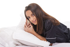 Woman in bed waking up Stock Image