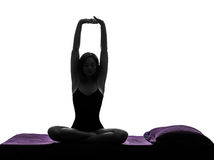 Woman in bed waking up stretching arms silhouette Stock Photography