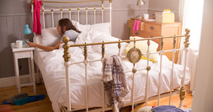 Woman In Bed Woken By Alarm On Mobile Phone Royalty Free Stock Images