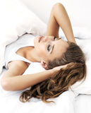 Woman in bed Stock Images