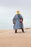 Woman in bedouin clothes in desert. Female in bedouin clothes standing on dune in Sahara desert Royalty Free Stock Photos