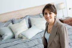Woman in bedroom Stock Photo