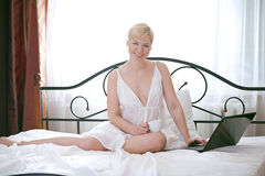 Woman in bedroom Stock Image