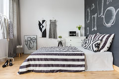 Woman bedroom with double bed stock images