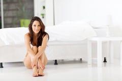 Woman on bedroom floor Royalty Free Stock Image