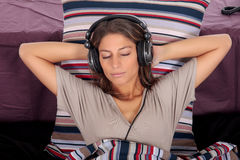 Woman bedroom headset Stock Photo