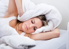 Woman with a bedsheet over her head Stock Images