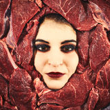 Woman and beef Royalty Free Stock Photography