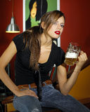 Woman with beer. Portrait of attractive young woman with beer royalty free stock photography