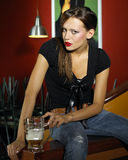 Woman with beer. Portrait of attractive young woman with beer royalty free stock photos